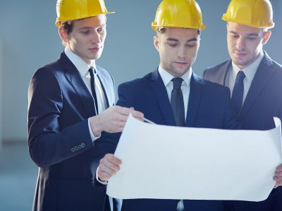 Closeup image of three constructors developing the business project